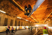 Two photographers in a skylift at the Stockholm Tunnel Run — Стоковое фото