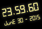 Digital clock with 60 seconds at midnight — Stock Photo