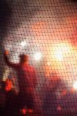 Blurred image of hooligans at an football stadium — Stock Photo