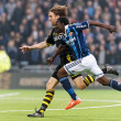 Two players chasing the ball in the soccer game DIF vs AIK at Te — Stock Photo #74341349