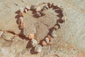 Stones in a heart shaped love sign — Stock Photo