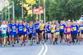 Runners just after the start at Lilla Midnattsloppet for aged 15 — Stock Photo