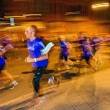 Male runners in motion blur and colorful light trails on the str — Stock Photo #81286850
