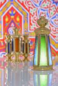 Four Shiny Lanterns over Ramadan Fabric — Stock Photo