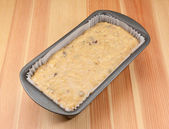 Banana bread batter in a loaf tin — Stock Photo