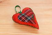 Handmade red plaid heart-shaped festive ornament — Stock Photo
