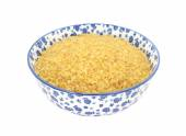 Bulgur wheat in a blue and white china bowl — Стоковое фото