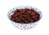 Dried cranberries in a blue and white china bowl — Стоковое фото