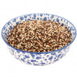 Mixed red, white and black quinoa in a blue and white china bowl — Stock Photo #65992171
