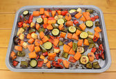 Roasted vegetables on a baking tray — Stock Photo