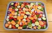 Chopped raw vegetables seasoned and drizzled with oil — Stock Photo