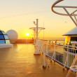 Sunset view from the deck of a cruise ship. — Stock Photo #53001041