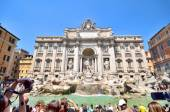 ROME, ITALY - AGOUST 19: Tourist taking pictures at Trevi Fountain on Agoust 19 2013 in Rome, Italy. This fountain is one of the most famous monuments in the world. — Stock Photo
