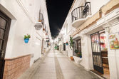 Typical street at night in the famous white village of Mijas, Malaga, Spain. — Photo