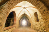 Fantasy corridor. Ancient Monastery corridor, with light at the end. — Stock Photo