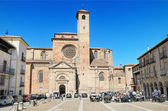 SIGUENZA, SPAIN - MARCH, 8 : Some tourist are relaxed in a terrace in front of the famous church in the major square of Siguenza, Guadalajara, Spain on March 8, 2014. — Stock Photo