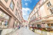 TALLINN, ESTONIA - JUNE 29: Popular street in old town. Some tourists are walking in a typical shopping street in the historical part of city — Stock Photo