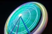 Beutiful Long exposure picture of a ferris wheel rotating, vivid colors. — Stock Photo