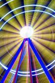 Beautiful Long exposure picture of a ferris wheel rotating, vivid colors. — Stock Photo
