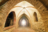 Fantasy corridor. Ancient Monastery corridor, with light at the end. — Stock Photo
