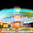 Light trails of a carrusel rotating — Stock Photo #54006293