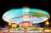 Light trails of a carrusel rotating — Stock Photo
