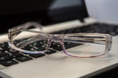 Eyeglasses with keyboard — Stock Photo