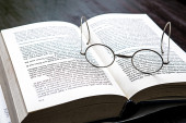Eyeglasses on book — Stock Photo