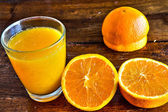 Orange juice in the glass — Stock Photo