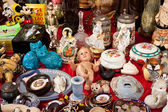 Baby Jesus doll and other vintage things for sale on flea market — Stock Photo