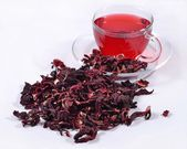 Cup of hibiscus tea and a dried petals of hibiscus  — Stock Photo