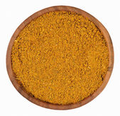 Curry powder  in a wooden bowl on a white — Stock Photo