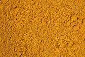 Curry powder background  — Stock Photo