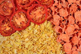 Dried  tomatoes, carrots and onions background  — Stock Photo