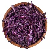 Sliced red cabbage in a wooden bowl on a white — Stock Photo
