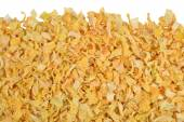 Heap of dried onions on a white — Stock Photo