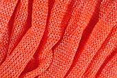 Orange crumpled stockinet background — Stock fotografie