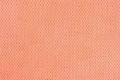 Orange nonwoven fabric background  — Stock Photo