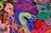 Colorful embroidery floss background — Stock Photo