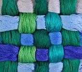 Colorful twisted skeins of floss as background texture — Stock Photo