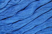 Blue skeins of floss as background texture — Stock Photo