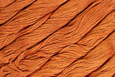 Brown skeins of floss as background texture — Stock Photo