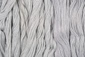 Gray skeins of floss as background texture — Stock Photo