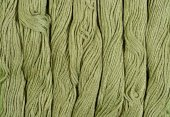 Green skeins of floss as background texture — Stock Photo