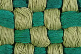 Green twisted skeins of floss as background texture — Stock Photo