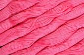 Pink skeins of floss as background texture — Stock Photo