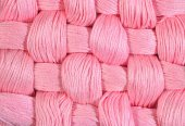 Pink twisted skeins of floss as background texture — Stock Photo
