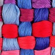 Colorful twisted skeins of floss as background texture — Stock Photo #75027717