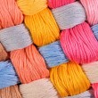 Colorful twisted skeins of floss as background texture — Stock Photo #75027633