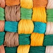 Colorful twisted skeins of floss as background texture — Stock Photo #75027831